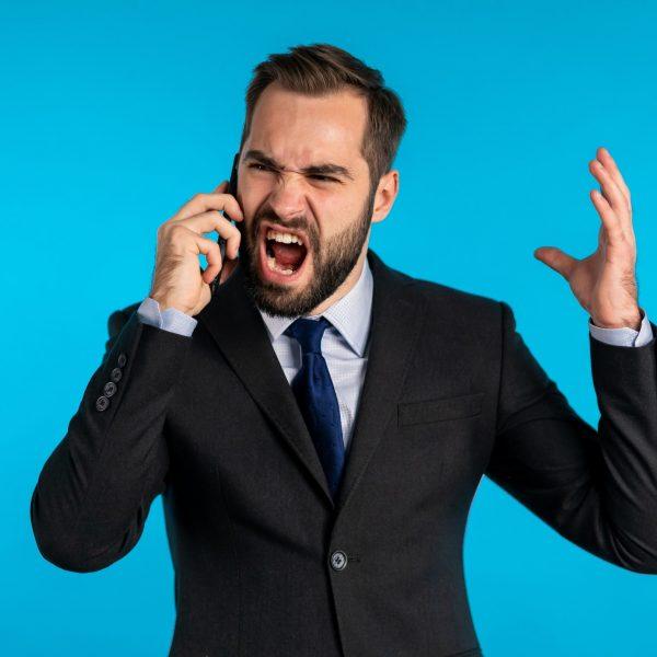 businessman-screaming-on-mobile-phone-having-nervous-breakdown-at-work-shouting-in-anger-stress_t20_1QZRNY